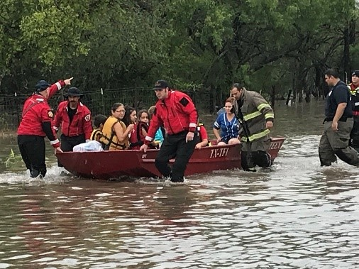 Disaster survivors in a boat in the flooded streets of McAllen. Credit: City of McAllen, TX