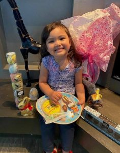 A child enjoys Easter treats from United Way El Paso County